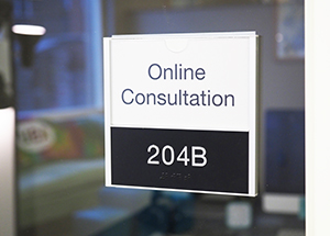 """online consultation"" sign on glass door"